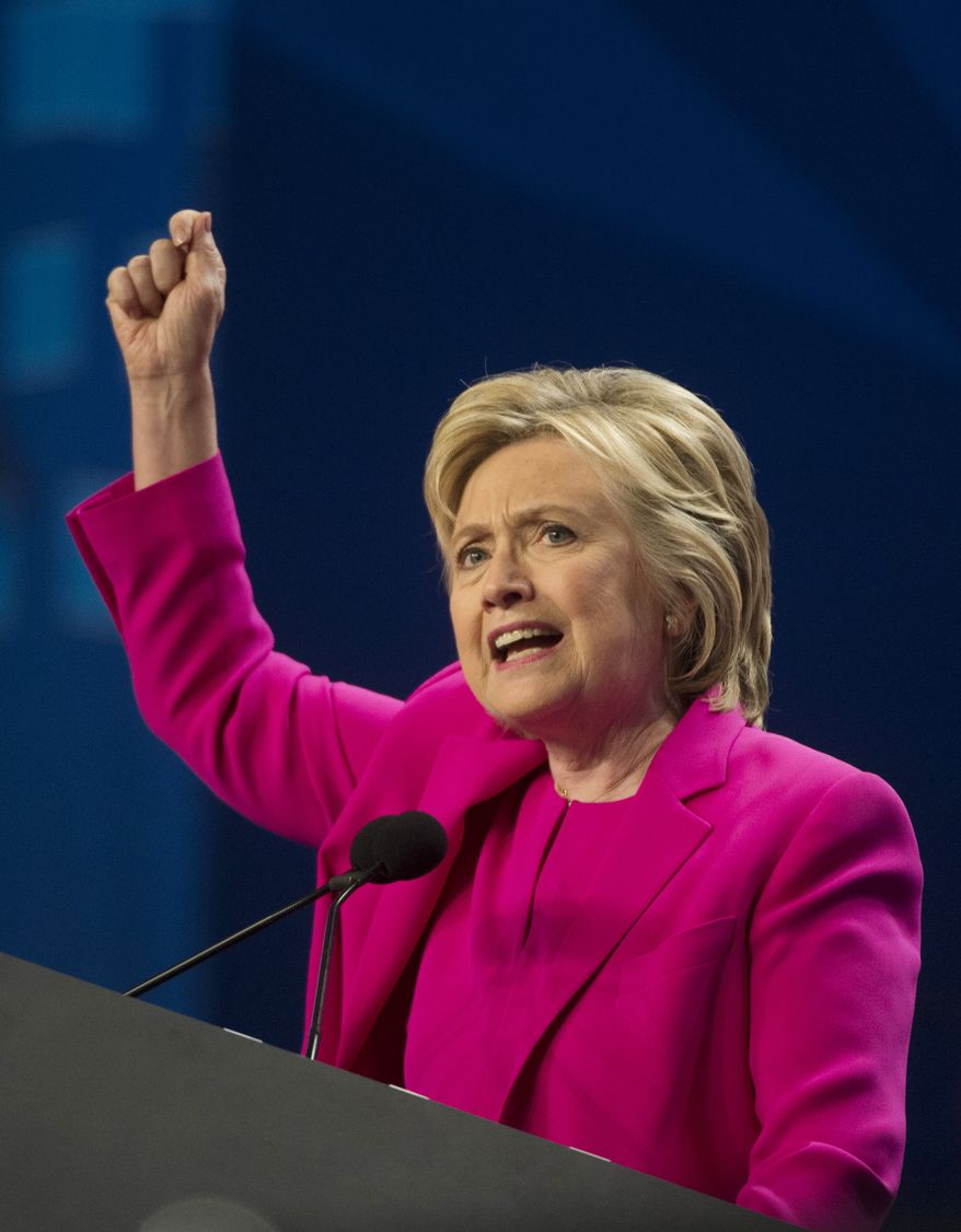 Democratic presidential candidate Hillary Clinton addresses the The National Education Association (NEA) Representative Assembly in Washington, Tuesday, July 5, 2016. (AP Photo/Molly Riley)