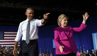 President Barack Obama and Democratic presidential candidate Hillary Clinton arrive at a campaign at the Charlotte Convention Center in Charlotte, N.C., Tuesday, July 5, 2016. Obama is spending the afternoon campaigning for Clinton. (AP Photo/Susan Walsh) ** FILE **