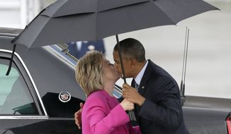 Democratic presidential candidate Hillary Clinton gets a goodbye kiss from President Barack Obama as they prepare to separate following a campaign stop in Charlotte, N.C., Tuesday, July 5, 2016. (AP Photo/Bob Leverone)