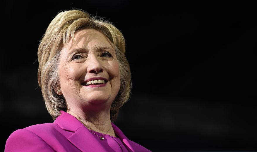 Democratic presidential candidate Hillary Clinton listens as President Barack Obama speaks about her during a campaign event at the Charlotte Convention Center in Charlotte, N.C., Tuesday, July 5, 2016. Obama is spending the afternoon campaigning for Clinton. (AP Photo/Susan Walsh)