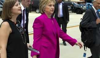 Democratic presidential candidate Hillary Clinton walks on the tarmac as she arrives to board Air Force One at Andrews Air Force Base, Md., Tuesday, July 5, 2016. President Barack Obama and Clinton are traveling to Charlotte, N.C. to campaign together. ( AP Photo/Jose Luis Magana)