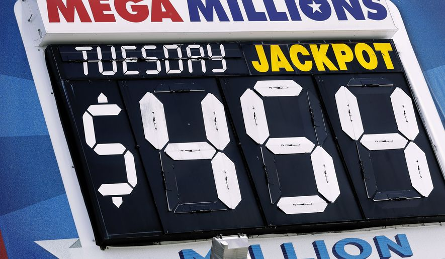 An electronic billboard displays the current Mega Millions jackpot Tuesday, July 5, 2016, in Springfield, Ill. With slightly better odds than Powerball, it's rare that nearly four months passes without someone winning a Mega Millions jackpot, which has grown from $15 million prize to $454 million since the last winning drawing in March. (AP Photo/Seth Perlman)