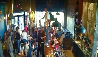 Diners at a restaurant in Idaho were sent into a panic Friday night after a young man stood on top of the bar and praised Allah as the only god. (KTVB)