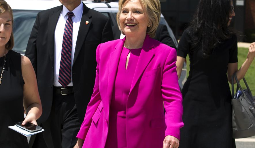 Democratic presidential candidate Hillary Clinton,  followed by aide Huma Abedin, right, walks on the tarmac as she arrives to board Air Force One at Andrews Air Force Base, Md., Tuesday, July 5, 2016. President Barack Obama Clinton are traveling to Charlotte, N.C. to campaign together. ( AP Photo/Jose Luis Magana)