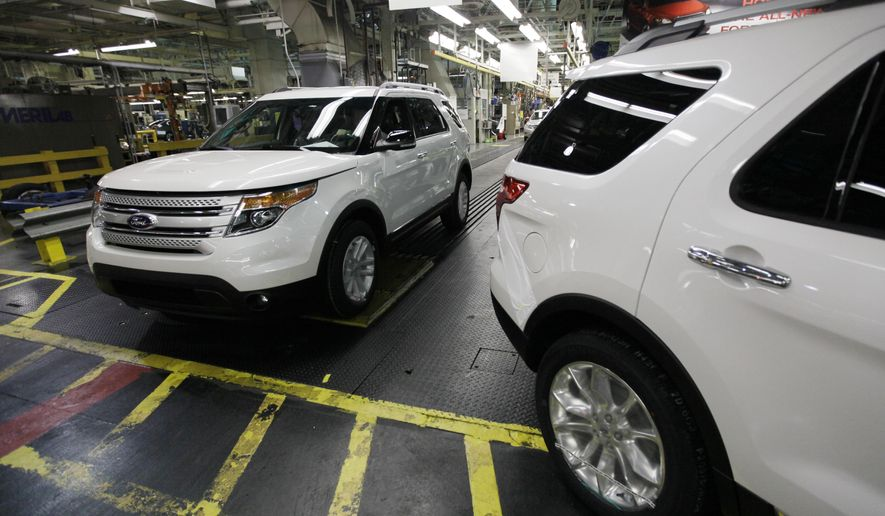 FILE - In this Dec. 1, 2010, file photo, plant employees drive 2011 Ford Explorer vehicles off the assembly line at Ford's Chicago Assembly Plant in Chicago. The U.S. government is investigating complaints from Ford Explorer owners who say they smelled exhaust gas inside their SUVs. The National Highway Traffic Safety Administration says it received 154 complaints involving Ford Explorers with model years between 2011 and 2015. (AP Photo/M. Spencer Green, File)