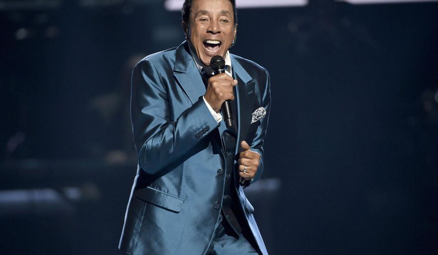 FILE - In this June 28, 2015, file photo, Smokey Robinson performs at the BET Awards in Los Angeles. Robinson has been honored by the Library of Congress with the Gershwin Prize for Popular Song. The national library announced Tuesday, July 5, 2016, that Robinson will receive the award this year.  (Photo by Chris Pizzello/Invision/AP, File)