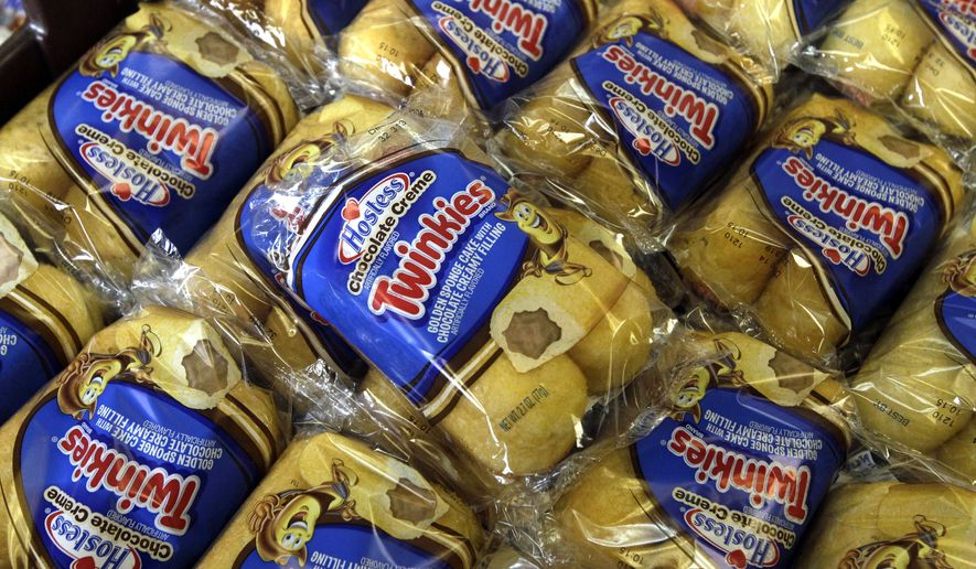 FILE - In this Nov. 16, 2013, file photo, Twinkies baked goods are displayed for sale at the Hostess Brands' bakery in Denver. Almost four years after seeking bankruptcy protection under a barrage of labor issues and rapidly changing appetites, the maker of Twinkies and Ding Dongs will take the stage once again as a publicly traded company Tuesday, July 5, 2016. (AP Photo/Brennan Linsley, File)