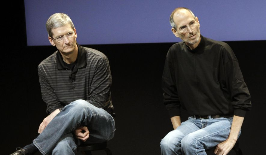 This July 16, 2010, file photo shows Apple's Tim Cook, left, and Steve Jobs, right, during a meeting at Apple in Cupertino, Calif. Apple wants to encourage millions of iPhone owners to register as organ donors through a software update that will add an easy sign-up button to the health information app that comes installed on every smartphone the company makes. (AP Photo/Paul Sakuma, File)