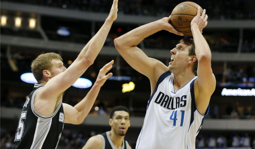 FILE - In this April 13, 2016, file photo, San Antonio Spurs' Matt Bonner, left, defends as Dallas Mavericks' Dirk Nowitzki (41), of Germany, attempts to shoot in the first half of an NBA basketball game in Dallas. A person with knowledge of the deal says the Mavericks and Nowitzki have reached agreement on a two-year contract that could get the star forward to 20 seasons in Dallas. The agreement would be worth roughly $20 million per season with a player option in the second year, the person told The Associated Press on Tuesday, July 5, 2016, on condition of anonymity because contracts can't be signed until late Wednesday night Central time. (AP Photo/Tony Gutierrez, File)
