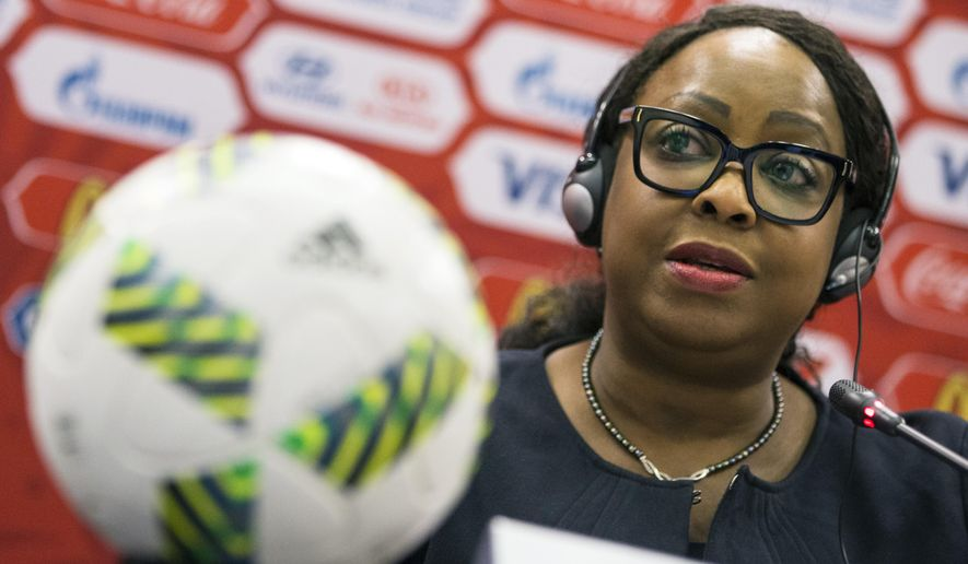 FIFA Secretary General Fatma Samoura speaks during a news conference in Moscow, Russia, Tuesday, July 5, 2016. Samoura says extra security measures are planned for the 2018 World Cup in Russia following hooligan violence at the European Championship. (AP Photo/Pavel Golovkin)