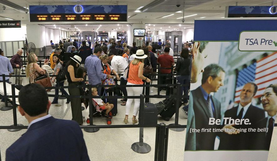 In this Thursday, May 26, 2016, photo, travelers stand in line as they prepare to pass through a Transportation Security Administration checkpoint at Miami International Airport, in Miami. The Transportation Security Administration said Tuesday, July 5, 2016, it will work with American Airlines to speed up security lines. The agency will test CT scanners in Phoenix, and roll out redesigned security lanes this fall in Chicago, Dallas, Los Angeles and Miami. (AP Photo/Alan Diaz)