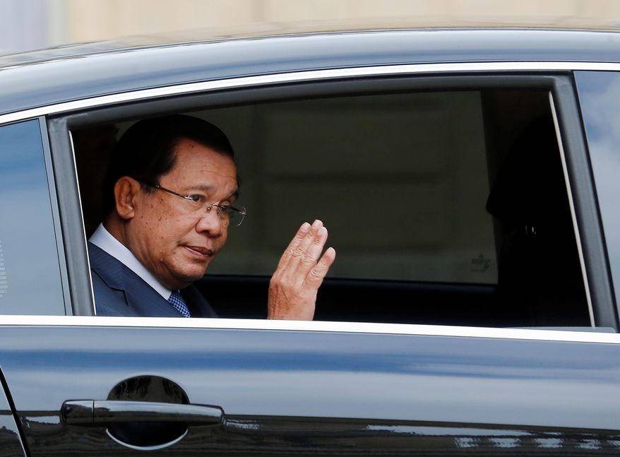 """London-based Global Witness charged that Cambodian Prime Minister Hun Sen's success at the polls is a result of """"electoral fraud and the brutal suppression of political opposition, including through murder, torture and arbitrary imprisonment."""" (Associated Press)"""