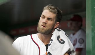 Washington Nationals right fielder Bryce Harper (34) walks in the dugout during a baseball game against the Milwaukee Brewers at Nationals Park, Wednesday, July 6, 2016, in Washington. (AP Photo/Alex Brandon)