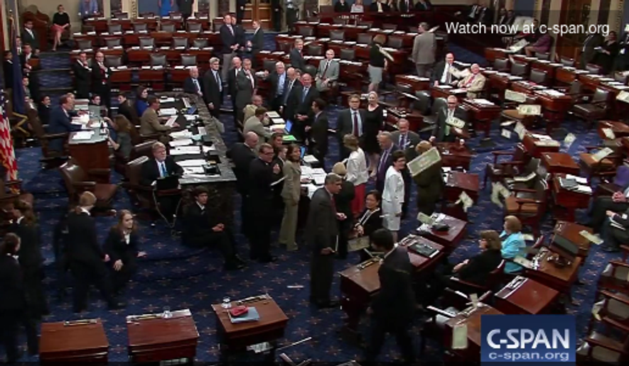 Protesters throw cash onto the Senate floor on Wednesday, July 6.