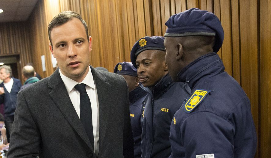 Oscar Pistorius, left, arrives inside the High Court in Pretoria, South Africa, Wednesday, July 6, 2016. (Marco Langari Pool Photo via AP)