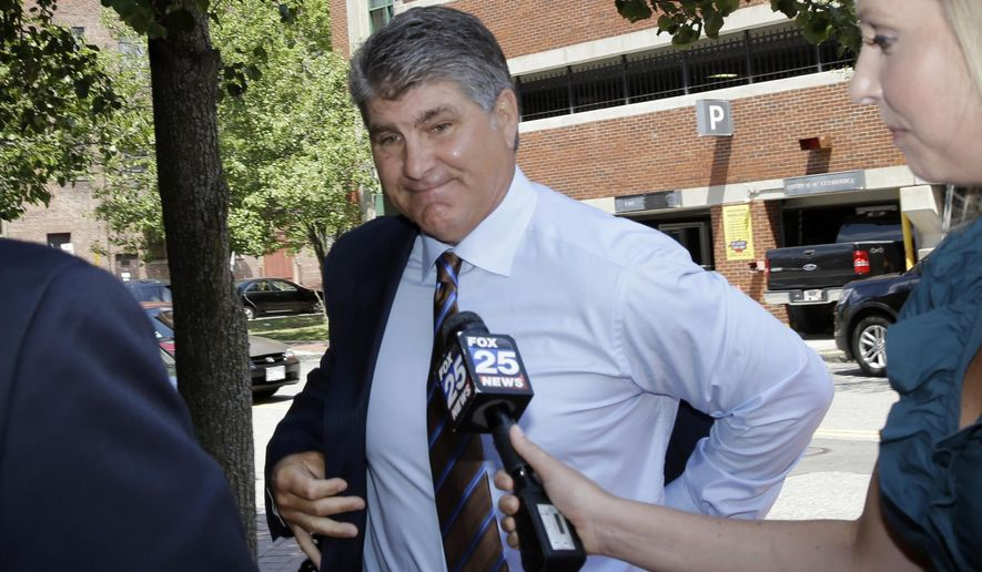 Former Boston Bruins star Ray Bourque walks into Lawrence, Mass. District Court, Wednesday, July 6, 2016, where he faces a charge of operating under the influence of alcohol after his Mercedes-Benz rear-ended a minivan in Andover on June 24. No one was hurt. (AP Photo/Elise Amendola)