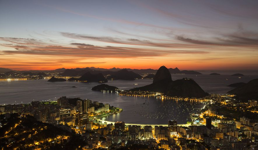 In this April 26, 2016 photo, the sun rises behind Sugar Loaf Mountain in Rio de Janeiro, Brazil. Broadcasters have already deemed the city's backdrop for the Summer Games the most telegenic ever. But no matter how good this teeming seaside metropolis looks on TV, footage simply can't compare with the experience of actually being here. (AP Photo/Felipe Dana)