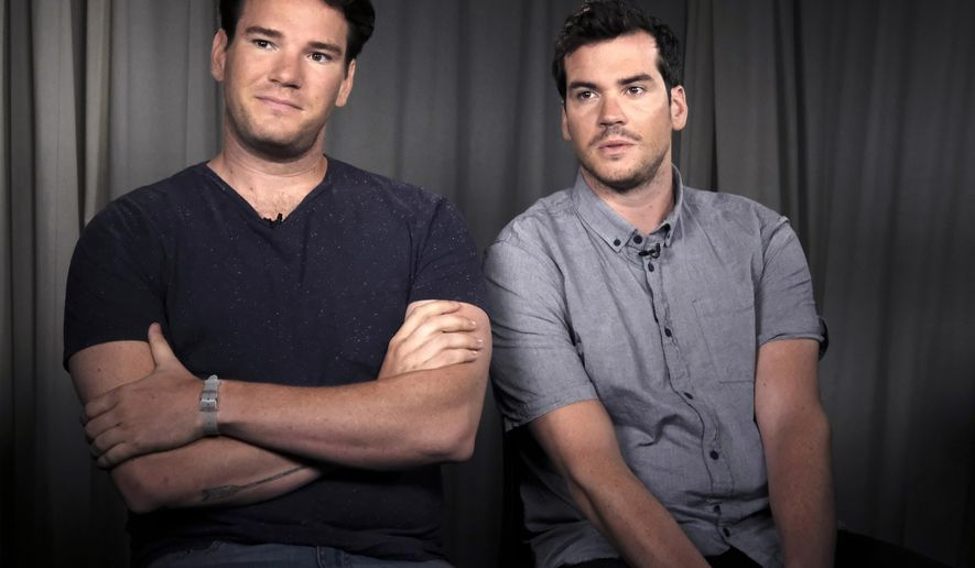 "In this June 29, 2016, photo, Mike Stangle, right, and his brother Dave appear during an interview in Los Angeles. The brothers posted an ad on Craigslist in search of dates for a cousin's wedding back in 2013. The ad went viral and the two parlayed a slew of crazy dates into book and a movie deal for, ""Mike and Dave Need Wedding Dates.""  (AP Photo/Richard Vogel)"
