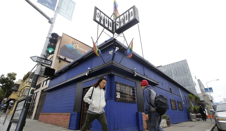 Pedestrians walk in front of The Stud bar in San Francisco, Wednesday, July 6, 2016. The Stud, one of the most iconic gay bars in the country, may be out of business this fall after its rent was raised. It's just one of many businesses going out of business in a San Francisco where climbing rents and new construction have old-timers fretting that the San Francisco they know is disappearing. (AP Photo/Jeff Chiu)