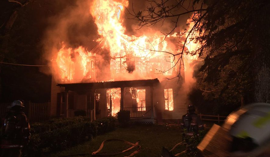 In this photo taken July 5, 2016, provided by Pete Piringer, Montgomery County, Md. Fire and Rescue, shows fire at Pleasant View Farm in Sandy Spring, Md. Officials say the fire destroyed the farmhouse that may have been built in the 18th century. (Pete Piringer, Montgomery County,Md. Fire and Rescue via AP)