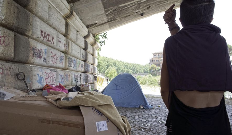 Alessia Pennachioli walks toward the tent she shared with her companion Massimo Galioto, 40, on the banks of river Tiber in Rome, Wednesday, July 6, 2016, after an interview with The Associated Press. Police on Tuesday detained Galioto as suspected for the death of Beau Solomon, a U.S. college student whose body was found in Rome's Tiber river this week. Alessia said the American fell into the water after a shoving match with Galioto. (AP Photo/Andrew Medichini)