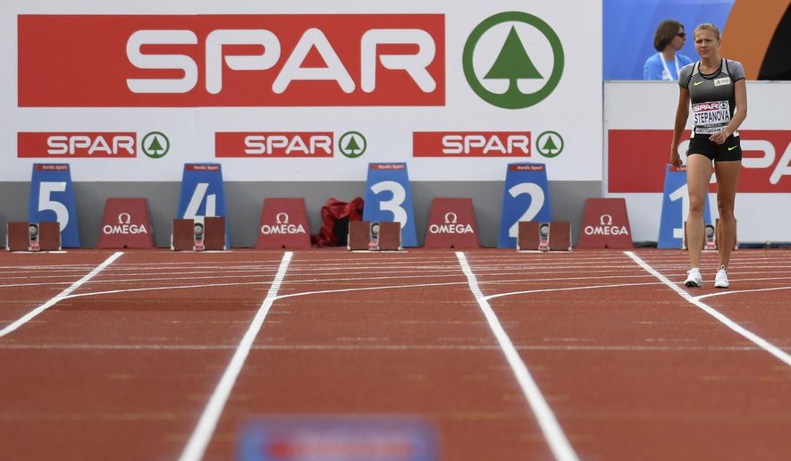 Russian doping whistleblower Yuliya Stepanova who runs under a neutral flag walks on the track after suffering an injury in a women's 800m heat during the European Athletics Championships in Amsterdam, the Netherlands, Wednesday, July 6, 2016. (AP Photo/Geert Vanden Wijngaert)