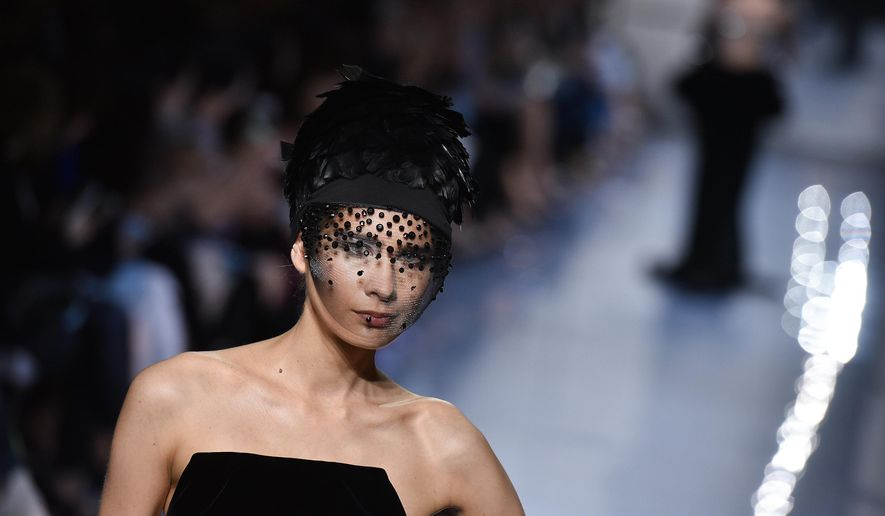 A model wears a creation as part of Giorgio Armani's fall-winter 2016-2017 Haute Couture fashion collection, presented in Paris, Tuesday July 5, 2016. (AP Photo/Zacharie Scheurer)