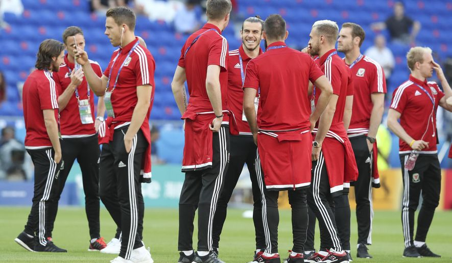 Wales' players inspect the pitch prior to the Euro 2016 semifinal soccer match between Portugal and Wales, at the Grand Stade in Decines-Charpieu, near Lyon, France, Wednesday, July 6, 2016. (AP Photo/Frank Augstein)