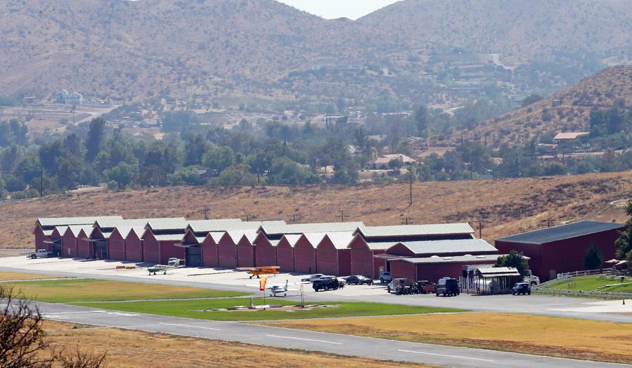 Agua Dulce Airpark, a small, rural airport in Agua Dulce, Calif., in northern Los Angeles County, is seen Wednesday, July 6, 2016. Fire officials say a stuntman was seriously injured Wednesday when he was pinned underneath a vehicle while filming. Los Angeles County Fire Inspector Richard Licon said the man was airlifted from the scene with major injuries from the accident. (AP Photo/Reed Saxon)
