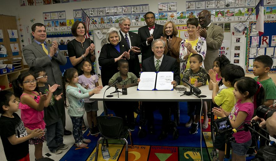 "FILE - In this May 28, 2015, file photo, Texas Gov. Greg Abbott poses for a photo after signing into law a pre-K boost that was among his top campaign promises but has underwhelmed educators in Austin, Texas. Abbott's cornerstone education plan that tea party activists rebuked as ""ungodly"" and Democrats bemoaned as meager finally doled out $116 million this week, but schools are getting only half as much money as what was teased. (Ralph Barrera/Austin American-Statesman via AP, File)"