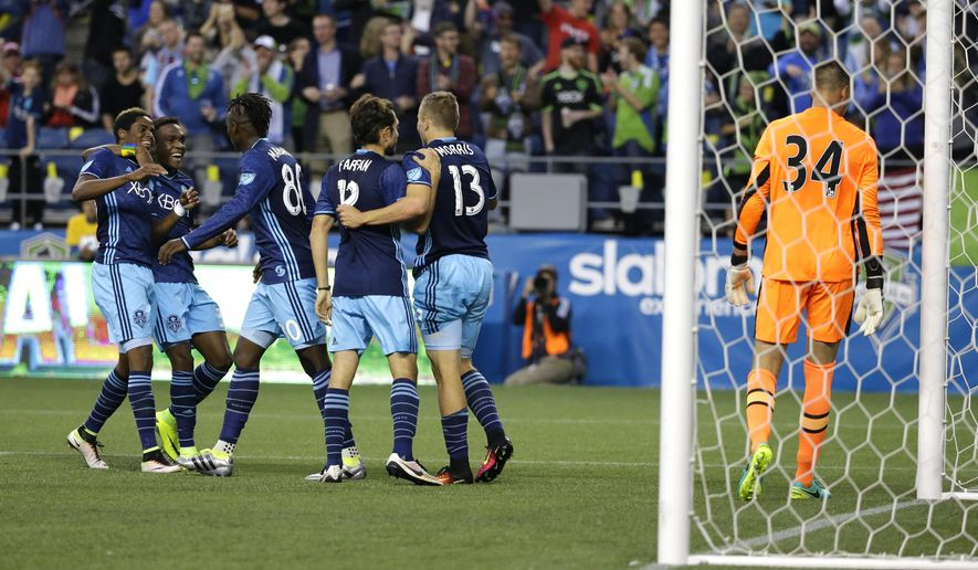 Seattle Sounders forward Jordan Morris (13) is greeted by teammates after Morris scored his second goal of the second half of an international friendly soccer match against West Ham United goalkeeper Raphael Spiegel, right, Tuesday, July 5, 2016, in Seattle. (AP Photo/Ted S. Warren)