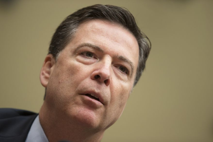 FBI Director James Comey testifies on Capitol Hill in Washington, Thursday, July 7, 2016, before the House Oversight Committee to explain his agency's recommendation to not prosecute Hillary Clinton, now the Democratic presidential candidate, over her private email setup during her time as secretary of state. (AP Photo/J. Scott Applewhite)