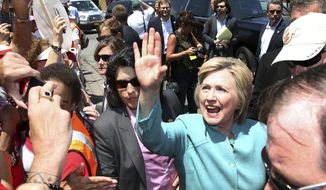 Democratic presidential candidate Hillary Clinton greets striking workers outside the Trump Taj Mahal Casino and Hotel Wednesday, July 6, 2016, in Atlantic City, N.J. (AP Photo/Mel Evans)