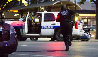 Dallas Police respond after shots were fired at a Black Lives Matter rally in downtown Dallas on Thursday, July 7, 2016. (The Dallas Morning News via Associated Press)