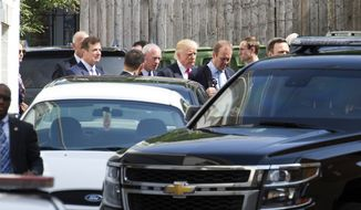 Republican presidential candidate Donald Trump departs a meeting with Republican House members at the Capitol Hill Club in Washington, Thursday, July 7, 2016. (AP Photo/Cliff Owen)