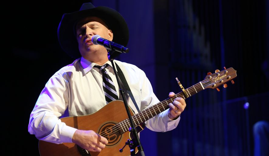 Garth Brooks performs at The Country Music Hall of Fame 2015 Medallion Ceremony at Country Music Hall of Fame and Museum in Nashville, Tenn., in this Oct. 25, 2015 file photo. Brooks announced Thursday, July 7, 2016,  that The Garth Channel on SiriusXM, will debut Sept. 8 and will feature songs from his albums, live recordings and commentary from the best-selling singer. (Photo by Laura Roberts/Invision/AP) **FILE**