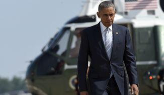 President Barack Obama walks from Marine One toward Air Force One at Andrews Air Force Base in Md., Thursday, July 7, 2016. Obama is traveling to Poland to attend a NATO summit and then on to Spain. (AP Photo/Susan Walsh)
