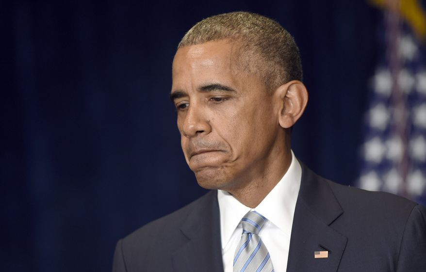 President Barack Obama pauses as he makes a statement on the fatal police shootings of two black men in Louisiana and Minnesota after arriving in Warsaw, Poland, Friday, July 8, 2016. Obama traveled to Poland to attend the NATO summit and then will travel on to Spain. (AP Photo/Susan Walsh)