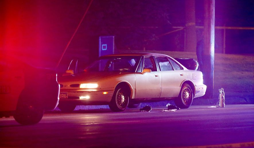 A car at the scene of a shooting of a man involving a St. Anthony Park Police officer Wednesday, July 6, 2016, in Falcon Heights, Minn. Police in Minnesota say a man has been taken to a hospital in unknown condition after being shot by an officer while inside a car with a woman and a child. St. Anthony Police interim police chief Jon Mangseth told reporters at a news conference that the incident began when an officer from his agency initiated a traffic stop around 9 p.m. Wednesday in Falcon Heights, a St. Paul suburb. (Leila Navidi/Star Tribune via AP)