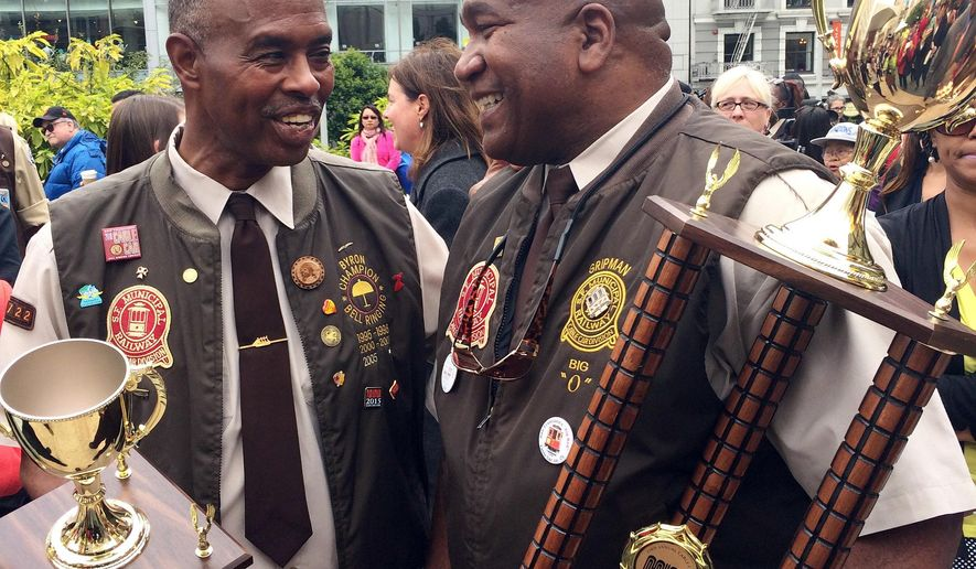 Defending champion Byron Cobb left speaks with this years winner Leonard Oats after the San Francisco Cable Car Bell Ringing Competition in San Francisco, Thursday, July 7, 2016. (AP Photo/Kristin Bender)