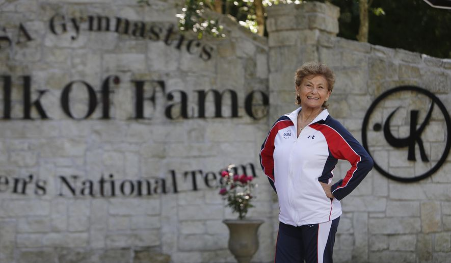 Marta Karolyi stands outside the Karolyi Ranch near New Waverly where she and her husband, Bela Karolyi, train gymnasts, including members of the Women's National Team, Wednesday, May 4, 2016, in Houston.  In her 16 years as the U.S. women's national team coordinator, Martha Karolyi has produced the most powerful team in the world, favorites to sweep the team title and a handful of individual medals at the 2016 Olympics.   (Mark Mulligan/Houston Chronicle via AP)