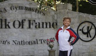 Marta Karolyi stands outside the Karolyi Ranch near New Waverly where she and her husband, Bela Karolyi, train gymnasts, including members of the Women's National Team, Wednesday, May 4, 2016, in Houston.  In her 16 years as the U.S. women's national team coordinator, Martha Karolyi has produced the most powerful team in the world, favorites to sweep the team title and a handful of individual medals at the 2016 Olympics.   (Mark Mulligan/Houston Chronicle via AP) **FILE**