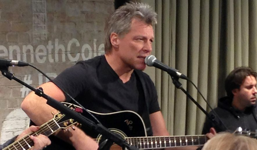 """FILE - In this Feb. 12, 2015, file photo, Jon Bon Jovi performs in New York as part an acoustic music series, Common Thread, an initiative created by the award-winning singer-songwriter, and fashion designer Kenneth Cole. Videos posted online in July 2016 show Bon Jovi taking the microphone to sing his band's 1986 classic """"Livin' on a Prayer."""" (AP Photo/John Carucci, File)"""