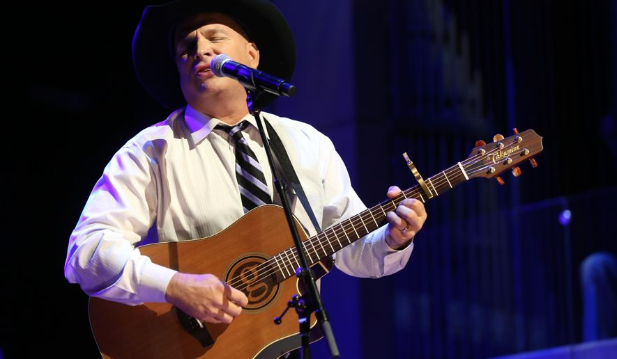 FILE - In this Oct. 25, 2015 file photo, Garth Brooks performs at The Country Music Hall of Fame 2015 Medallion Ceremony at Country Music Hall of Fame and Museum in Nashville, Tenn.  Brooks announced Thursday, July 7, 2016,  that The Garth Channel on SiriusXM, will debut Sept. 8 and will feature songs from his albums, live recordings and commentary from the best-selling singer. (Photo by Laura Roberts/Invision/AP)