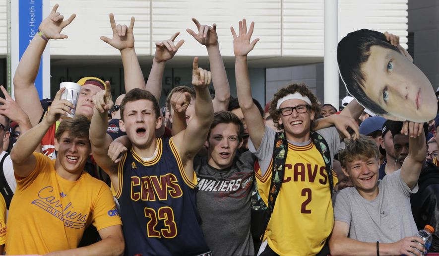 FILE - In this June 22, 2016, file photo, Cleveland Cavaliers fans cheer as they wait for the parade of the NBA basketball team to begin. The NBA said on July 7, 2016, that Cavaliers gear is the most popular among NBA team merchandise for the first time since January 2015. (AP Photo/Tony Dejak, File)
