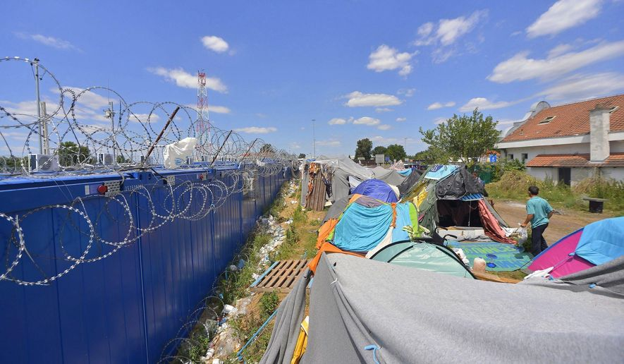 A migrant man at a temporary camp on the Serbian side of the Serbian-Hungarian border near Kelebia, Serbia, Tuesday, July 5, 2016.  Hungarian authorities introduced new border regulations Tuesday, to stem the uncontrolled inflow of illegal migrants and guarantees an opportunity to have their asylum requests considered. (Edvard Molnar/MTI via AP)