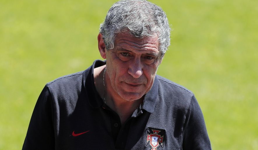 Portugal coach Fernando Santos walks on the pitch during a training session on the day after the Euro 2016 semifinal soccer match between Portugal and Wales, in Marcoussis, south of Paris, Thursday, July 7, 2016. (AP Photo/Francois Mori)