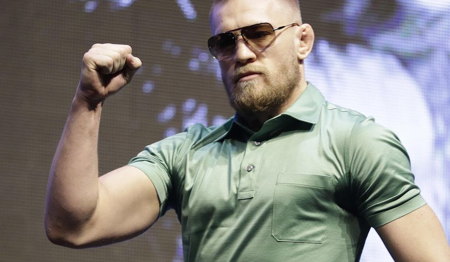 Conor McGregor arrives at a UFC 202 mixed martial arts news conference, Thursday, July 7, 2016, in Las Vegas. McGregor is scheduled to fight Nate Diaz at UFC 202 in Las Vegas. (AP Photo/John Locher)