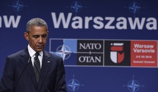 President Barack Obama listens to Polish President Andrzej Duda offering condolences before making statements following their meeting at PGE National Stadium in Warsaw, Poland, Friday, July 8, 2016. Obama is in Warsaw to attend the NATO Summit. (AP Photo/Susan Walsh)