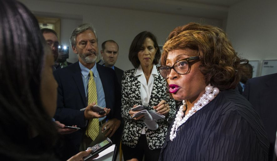 Rep. Corrine Brown, D-Fla., talks with the press in Tallahassee, Fla., in this Aug. 13, 2015, file photo. Brown has been indicted after a federal investigation into a fraudulent charity with ties to the congresswoman. (AP Photo/Mark Wallheiser, File)